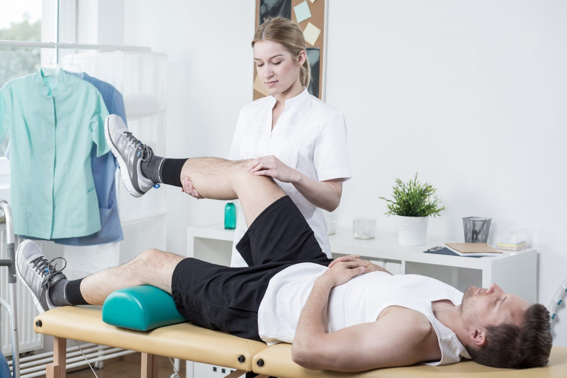 Chiropractor exercising mans l Physical therapy honolulu